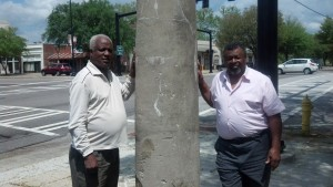 Pictured on Tuesday, April 16, 2013 at the Historic Broad Street Slave Market Pillar in Augusta, GA are social justice activists Arthur Smith, Jr. (left), a resident of the Hyde Park neighborhood in south Augusta (infamous for an industrial environmental racism scandal that killed countless blacks) - and the Rev. Zack Lyde (right) of Brunswick, Georgia, who has actively battled many forms of racism in Georgia and the South East. (Photo by Rev. Terence A. Dicks of Augusta)